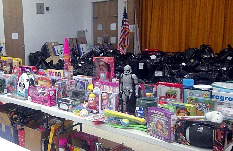 New and gently used children&#39s gift items await distribution day in the Park Street Cafeteria las