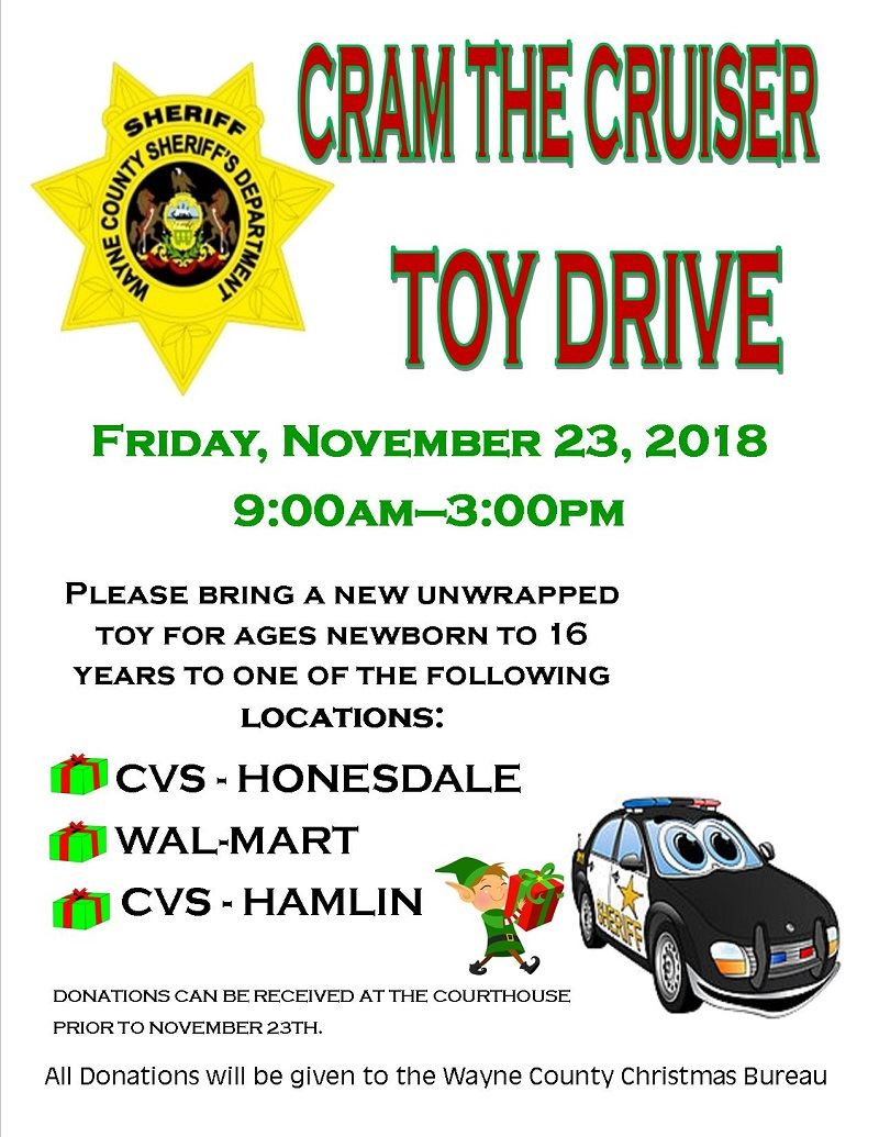 A poster announcing the Cram the Cruiser Toy Drive sponsored by the Sheriff&#39s Department.