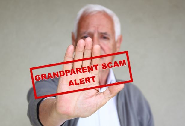 Older man holds out his hand in a stop gesture with Grandparent Scam alert over it.