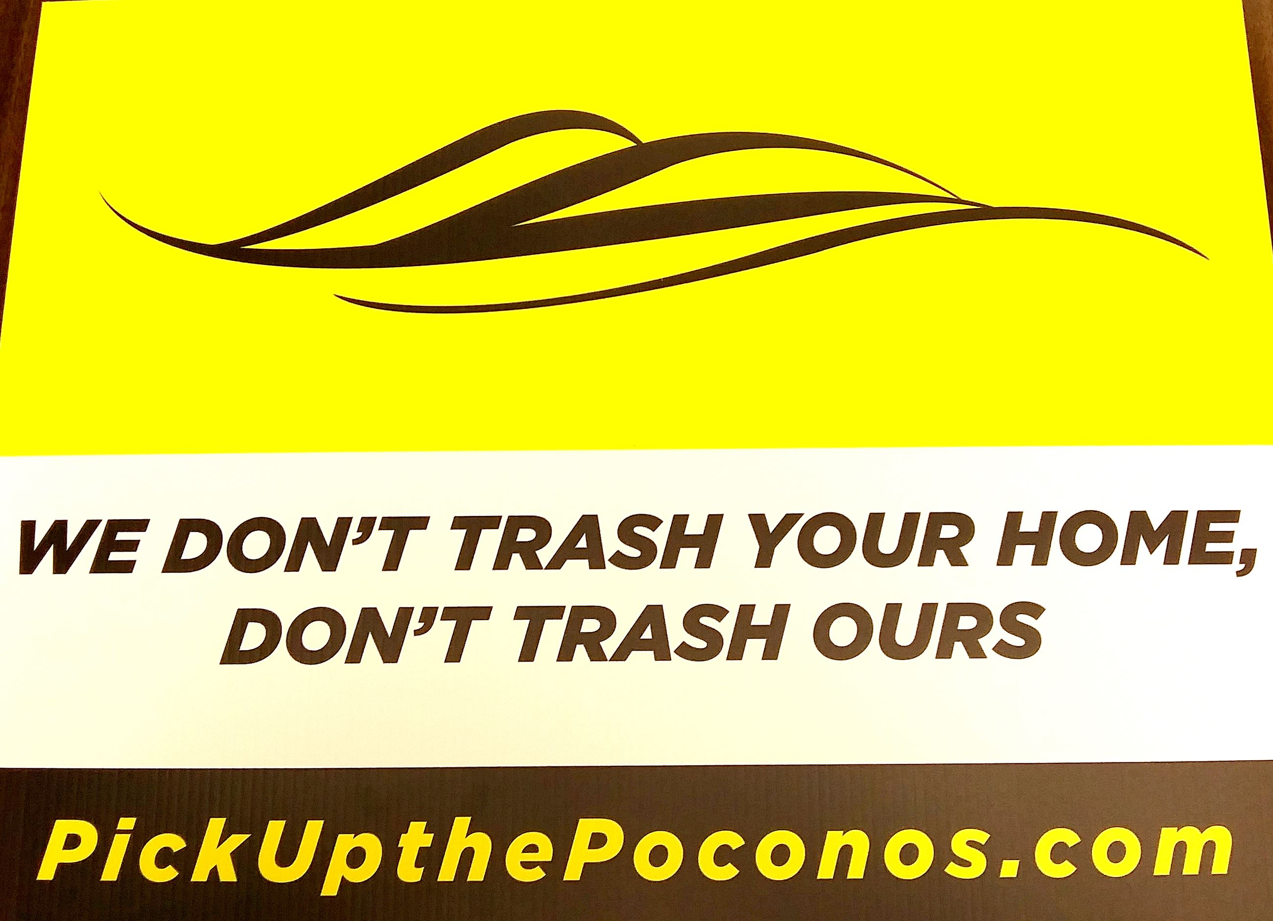 A yard sign with the Pocono Mountains Vacation Bureau swoop logo advising people &#34We don&#39t tra