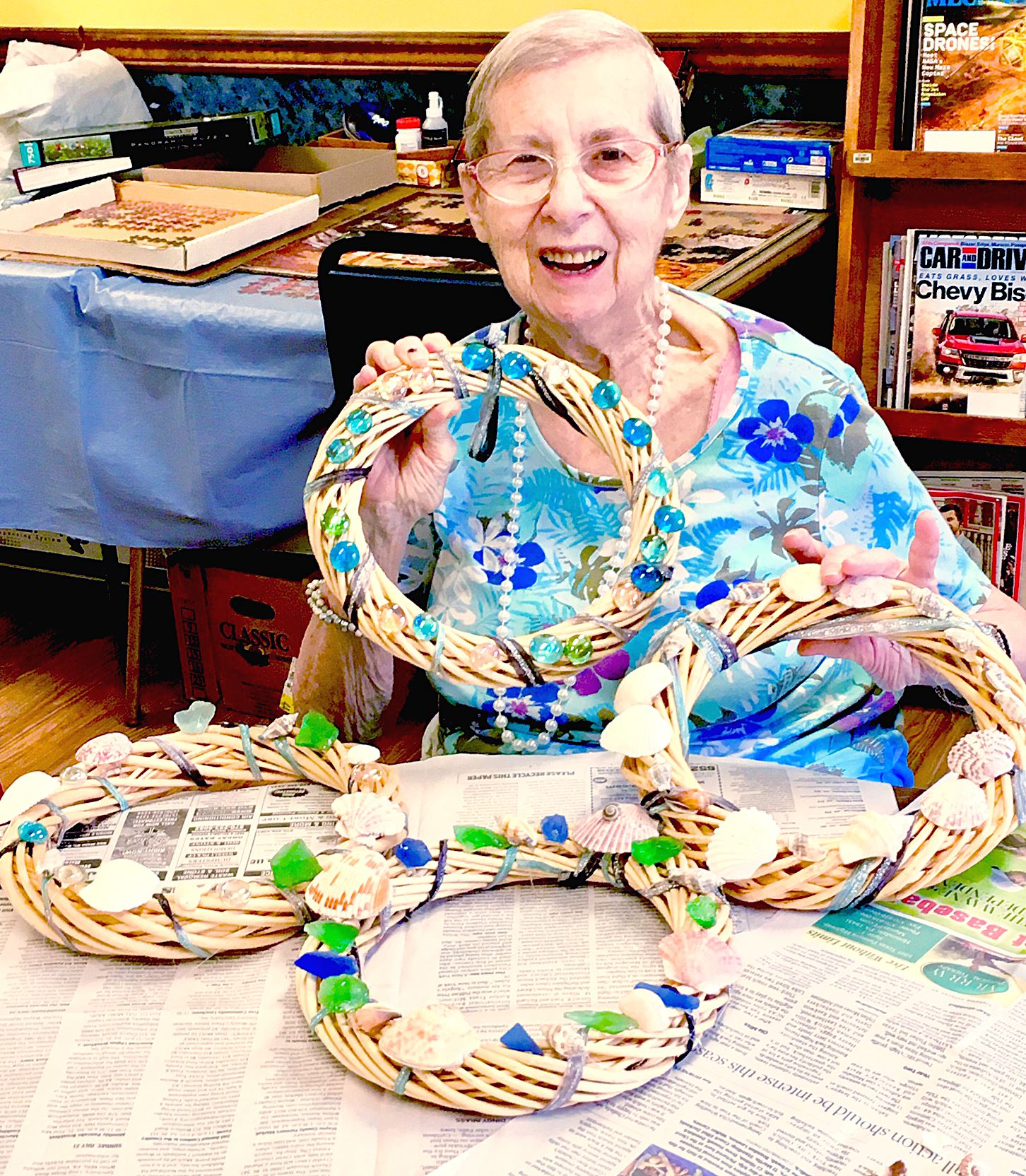Honesdale Senior Center attendee NancyDavis poses with the decorative summer wreath made by the free