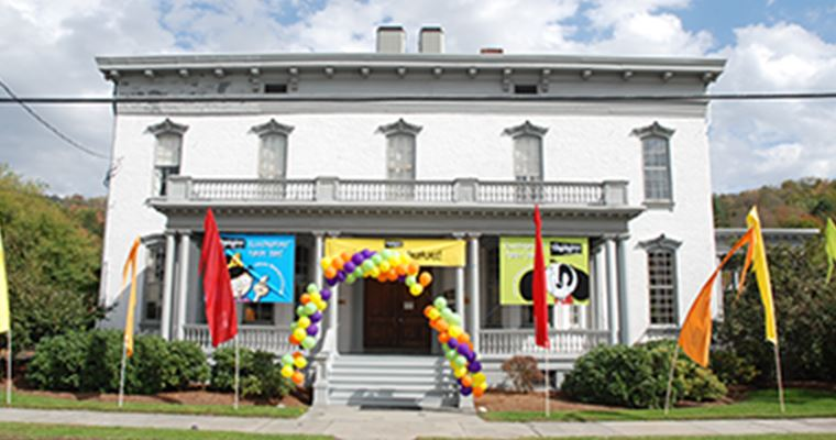 Older building with balloons and banners for a special event