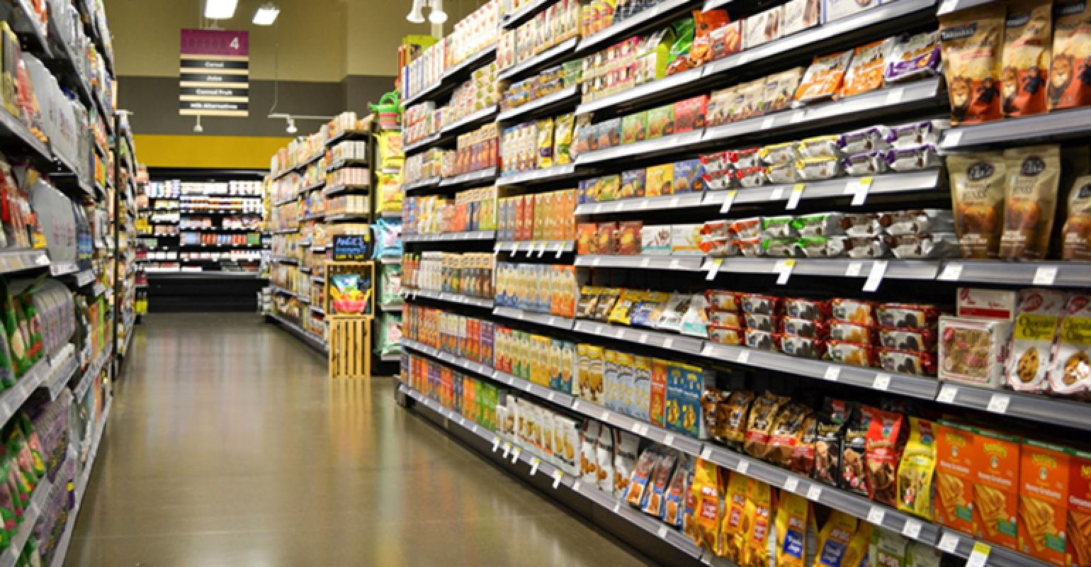 A photograph of a aisle in a grocery store.
